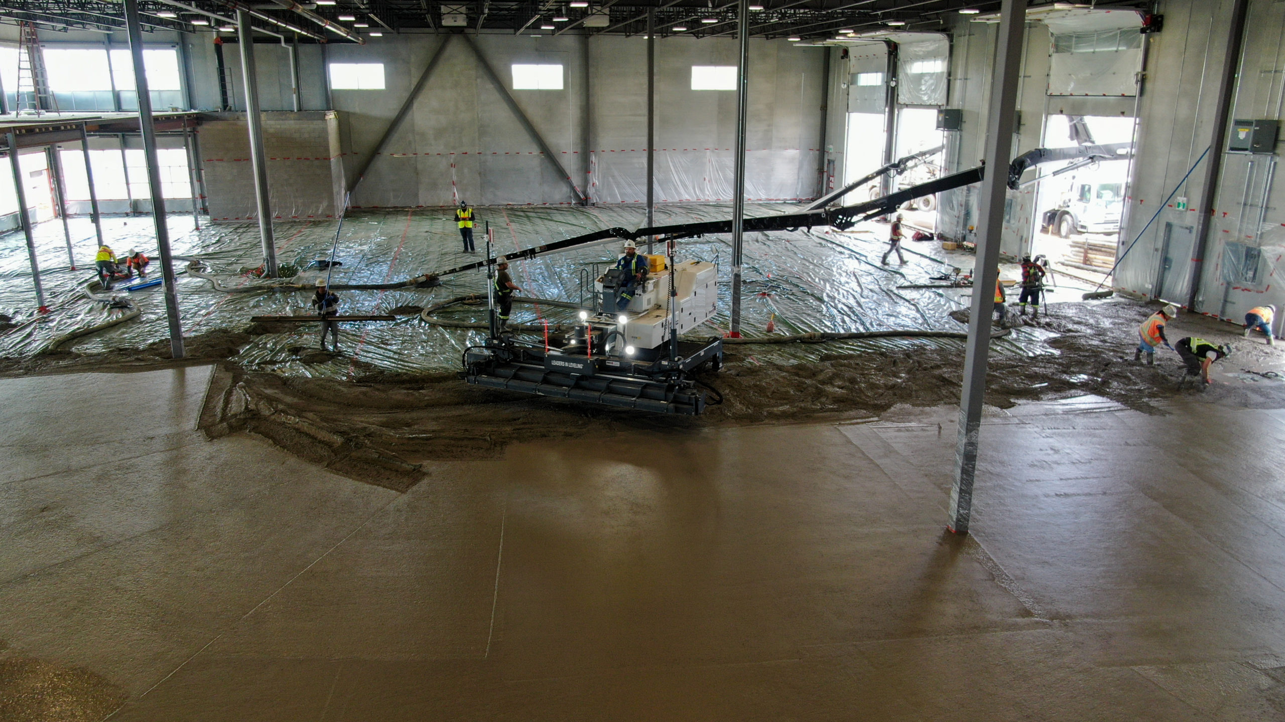 Dynamic Concrete Pumping placing concrete floors at the HF11 industrial condo development project