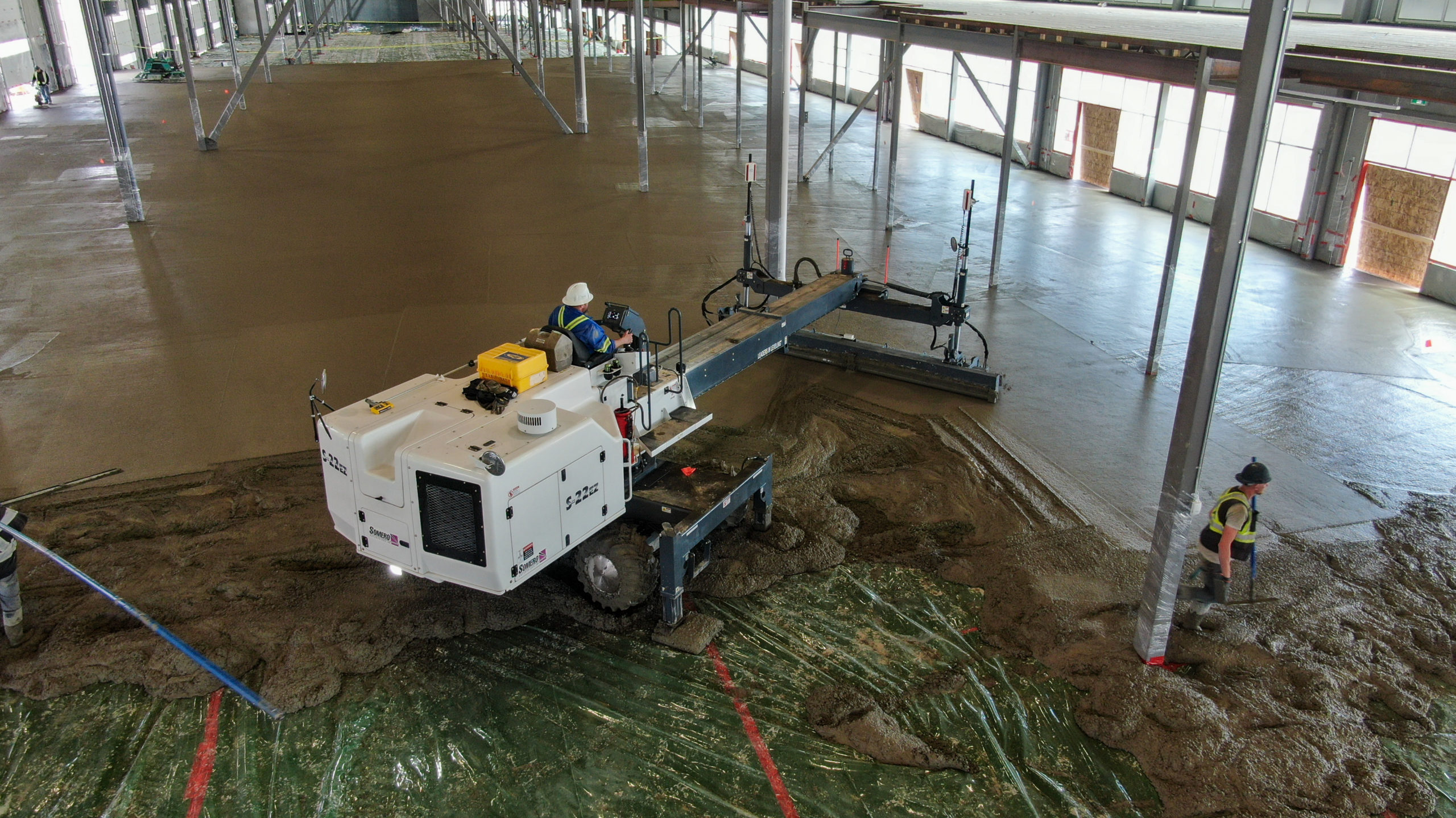 Dynamic Concrete Pumping placing superflat floors in the HF11 industrial condo development